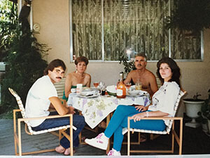 Brenda and Cesar share a meal with Maria who had Alzheimer's